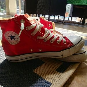 Red hightop Chuck Taylor Converse.